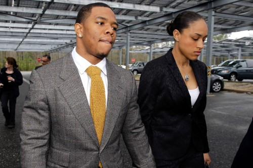 The longest walk: Rice and Palmer hold hands on the way to court.